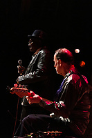 """The 59th Annual University of Chicago Folk Festival was held this weekend, Friday, February 15, 2019 and Saturday, February 16th, 2019 at the University of Chicago. The event was sponsored by The University of Chicago Folklore Society.<br /> <br /> 6837 – Elmore James Jr. and Frank Krakowski on guitar perform a blues set Friday, February 15th, 2019 at Mandel Hall located at 1132 E. 57th Street.<br /> <br /> Please 'Like' """"Spencer Bibbs Photography"""" on Facebook.<br /> <br /> Please leave a review for Spencer Bibbs Photography on Yelp.<br /> <br /> Please check me out on Twitter under Spencer Bibbs Photography.<br /> <br /> All rights to this photo are owned by Spencer Bibbs of Spencer Bibbs Photography and may only be used in any way shape or form, whole or in part with written permission by the owner of the photo, Spencer Bibbs.<br /> <br /> For all of your photography needs, please contact Spencer Bibbs at 773-895-4744. I can also be reached in the following ways:<br /> <br /> Website – www.spbdigitalconcepts.photoshelter.com<br /> <br /> Text - Text """"Spencer Bibbs"""" to 72727<br /> <br /> Email – spencerbibbsphotography@yahoo.com<br /> <br /> #SpencerBibbsPhotography <br /> #HydePark <br /> #Community <br /> #Neighborhood<br /> #CanonUSA"""