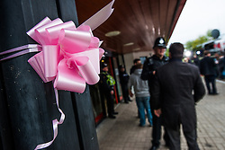 © Licensed to London News Pictures. 05/10/2012. Machynlleth Powys Wales .Pink ribbons (symbolising support for the family) are  tied outside Machynlleth leisure centre,  the centre of efforts to find five year old girl APRIL JONES abducted whilst playing outside her house on Oct 1 2012. Police are now treating this as a murder investigation and are continuing to question 46 year old local man MARK BRIDGER .Photo credit: Keith Morris/LNP