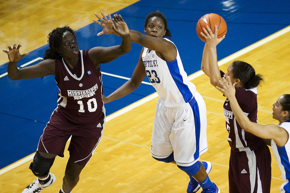 UK forward/center Samarie Walker, center, plays defense on Mississippi State center Martha Alwal on a pass from Mississippi State guard Candace Foster in the first half. The University of Kentucky Women hosted Mississippi State University Thursday, Jan. 17, 2013 at Memorial Coliseum in Lexington. Photo by Jonathan Palmer