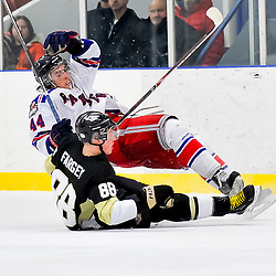NORTH YORK, ON - Feb 9 : Ontario Junior Hockey League Game Action between North York Rangers Hockey Club and the Trenton Golden Hawks Hockey Club.  Kyle Thacker #44 of the North York Rangers Hockey Club falls after colliding with Hunter Fargey #88 of the Trenton Golden Hawks Hockey Club.<br /> (Photo by Phillip Sutherland / OJHL Images)