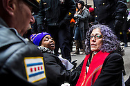 A sit down protester is arrested by Chicago Police during a rally on March 27, 2013 protesting the closing of 54 Chicago public schools. Hundreds of teachers, school employees, parents, students and community members came out to the protest the schools closings which are expected to effect more than 30,000 students in the Chicago Public School system.