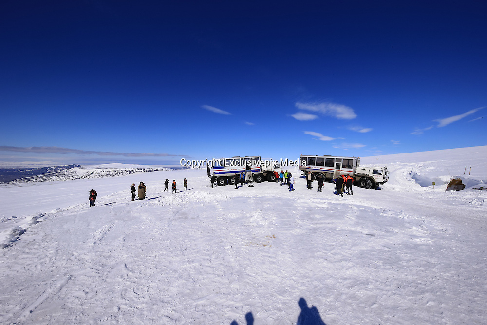 """Iceland Opens Man-Made Ice Tunnel in Langjokull Glacier<br /> <br /> The world's largest man-made ice tunnel was recently dug out on the western slopes of one of the biggest glaciers in Iceland - Langjokull. The tunnel and cave system stretches for 550 meters into solid glacier ice at about 30 meters below the surface making it the largest man made ice structure in the world. This unique project, backed by the Icelandair Group and leading pension funds, will enable visitors to have a rare opportunity to see how snow is gradually compressed to become glacier ice.<br /> <br /> Aptly named """"Into the Glacier"""", the experience is the brainchild of two Icelandic adventure tour operators - Baldvin Einarsson and Hallgrímur Örn Arngrímsson, who wanted to take visitors into the heart of the extraordinary glacier ice cap, to see the magnificent """"blue ice"""" which is buried deep beneath the surface.<br /> <br /> Work on the cave began in 2010, and completed early this year. It was official opened for visitors on 1st June 2015. Although its meant primarily to be a tourist attraction, the tunnel will also be used by researchers and students at the University of Iceland to measure ice movements over time.<br /> <br /> The journey to the ice tunnel starts off with an epic trip in 8-wheel monster trucks to the entrance of the cave, which is located 1,200 meters above sea level. From there visitors are taken on foot on an hour-long tour exploring the tunnel where they will see crevasses, moulins, running water, ice layers and space between them, different types of snow and ice, and how the glacier evolves. The led lighted walls inside the tunnels are sheer-carved and hollowed out at various intervals along the tunnel to house educational exhibitions and provide information on the science of glaciers and the effects of global warming. There is even a small chapel where couples can get married.<br /> <br /> The attraction is expected to stay open all throughout the year.<br /> ©Roman Gera"""