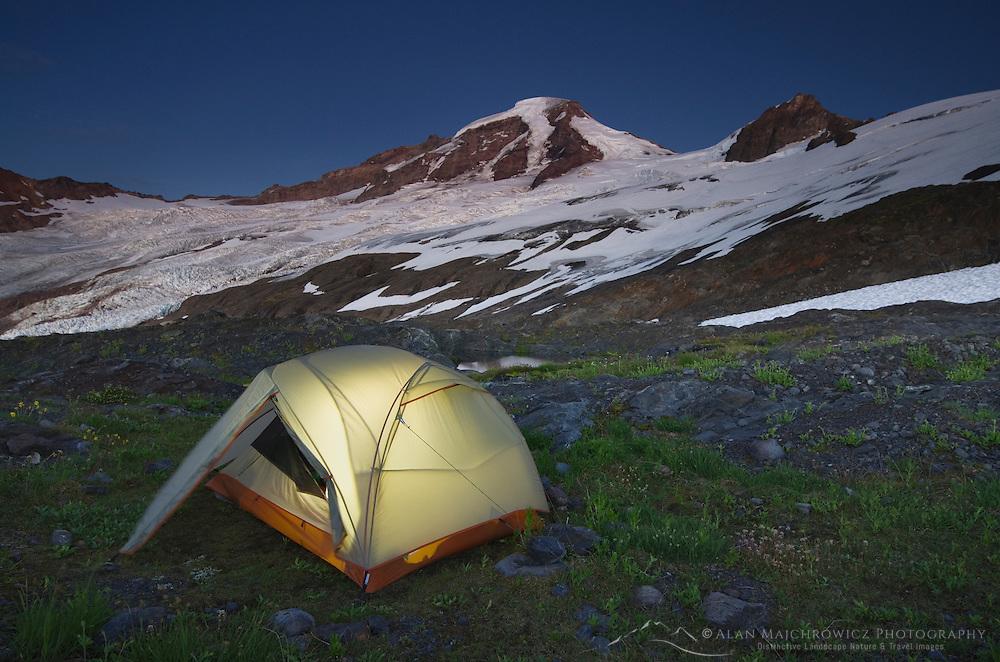 Tent illuminated at dusk on climbers camp on slopes of Heliotrope Ridge, Mount Baker Wilderness North cascades Washington
