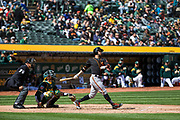 San Francisco Giants right fielder Gregor Blanco (1) swings at a Oakland Athletics pitch at Oakland Coliseum in Oakland, California, on March 25, 2018. (Stan Olszewski/Special to S.F. Examiner)