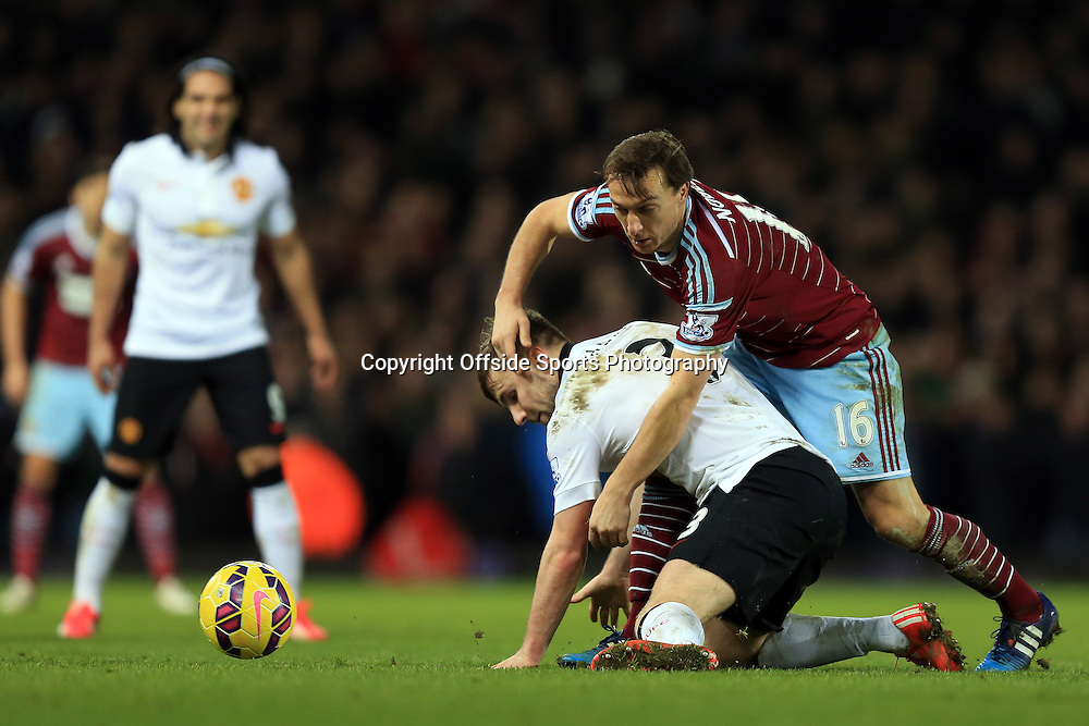 8 February 2015 - Barclays Premier League - West Ham United v Manchester United - Luke Shaw of Manchester United tangles with Mark Noble of West Ham - Photo: Marc Atkins / Offside.