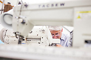 DEXTER, ME - AUGUST 4, 2015:  Scott Mayer, co-owner of Erda Handbags, repairs a sewing machine at the company's production facility in Dexter, Maine. Since most of Erda's employees are 60 years or older they have implemented a flexible scheduling system and invested in more ergonomic machines to accommodate their aging workforce. <br /> Craig Dilger for The New York Times