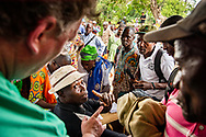 A large group of patients cluster around the registration area on the first day of the LCMS Mercy Medical Team on Monday, May 7, 2018, in the Yardu village outside Koidu, Sierra Leone, West Africa. LCMS Communications/Erik M. Lunsford