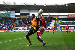 Peter Odemwingie challenges for the ball with Moses Odubajo of Hull City - Mandatory by-line: Dougie Allward/JMP - 02/04/2016 - FOOTBALL - KC Stadium - Hull, England - Hull City v Bristol City - Sky Bet Championship