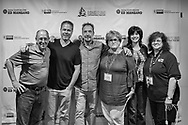 "Bellmore, New York, USA. 19th July 2017.  L-R, HENRY STAMPFEL, BRAD KUHLMAN, LOU DiMAGGIO, TRISH APPELLO, Maria Pusateri, and ANNE STAMPFEL pose during final Screening Night of Long Island International Film Expo 2017 at Bellmore Movies. The last film screened was the feature documentary ""Where Have You Gone, Lou DiMaggio?"" by Director Brad Kuhlman about comedian Lou DiMaggio contemplating a comeback after 20 year away from stand-up comedy. Henry and Anne Stampfel are the owners the Bellmore Movies, and two of the co-founders of LIIFE. Henry Stampfel is President Chairman Treasure and Trish Appello is Secretary of the Long Island Film/TV Foundation which, along with Nassau County Film Commission presented LIIFE 2017."