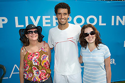LIVERPOOL, ENGLAND - Thursday, June 17, 2010: Andre Sa (BRA) with two Brazillian fans on day two of the Liverpool International Tennis Tournament at Calderstones Park. (Pic by David Rawcliffe/Propaganda)