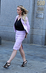 Adult-film star Stormy Daniels who is entangled in a legal fight with U.S. President Donald Trump's longtime personal lawyer Michael Cohen exits with security guards after a hearing in New York City, NY, USA on April 16, 2018. U.S. President Donald Trump's longtime personal lawyer Michael Cohen also arrived at Manhattan Federal Court on Monday for a showdown over documents seized as part of a federal investigation that could cast a harsh light on Trump's business and personal relationships. Photo by Dennis Van Tine/ABCACAPRESS.COM