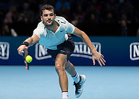 Tennis - 2017 Nitto ATP Finals at The O2 - Day Seven<br /> <br /> Semi Finals: Grigor Dimitrov (Bulgaria) Vs Jack Sock (United States)<br /> <br /> Grigor Dimitrov (Bulgaria) with tongue out stretches for the return knowing he is almost in the Final at the O2 Arena <br /> <br /> COLORSPORT/DANIEL BEARHAM