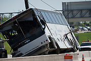 Hours after a Cardinal Coach Line charter bus wrecked on Hwy. 161 near N. Belt Line Rd. in Irving crews flip it upright on Thursday, April 11, 2013. The accident resulted in two deaths and 41 hospitalized. (Cooper Neill/The Dallas Morning News)