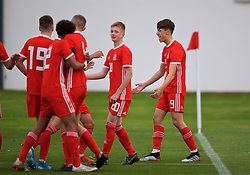WREXHAM, WALES - Wednesday, October 30, 2019: Wales' Christopher Popov (R) celebrates scoring the third goal during the 2019 Victory Shield match between Wales and Republic of Ireland at Colliers Park. (Pic by David Rawcliffe/Propaganda)