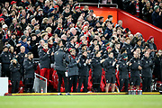 Liverpool Manager Jurgen Klopp and the Liverpool bench take part in the minutes applause in memory of the 96  during the Premier League match between Liverpool and Everton at Anfield, Liverpool, England on 4 December 2019.