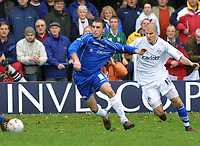 Photo: Dave Linney.<br />Chasetown v Oldham Athletic. The FA Cup. 06/11/2005.<br />Karl Edwards(Chasetown) beats his marker to the ball(Mark Tierney)