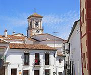 Whitewashed houses cluster around church tower, village of Grazalema, Cadiz province, Spain