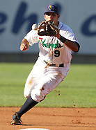 Kernels third baseman Jeremy Cruz (9) fields a ground ball during the first inning of their game at Perfect Game Field at Veterans Memorial Stadium in Cedar Rapids on Wednesday, June 9, 2010. The Kernels defeated the Whitecaps 5-2.