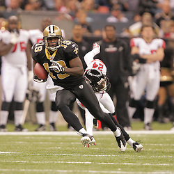 2008 December, 07: New Orleans Saints wide receiver Devery Henderson (19) runs away from Atlanta Falcons cornerback Domonique Foxworth (24) after a catch during a 29-25 victory by the New Orleans Saints over NFC South divisional rivals the Atlanta Falcons at the Louisiana Superdome in New Orleans, LA.