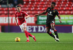 Charlton Athletic Jake Forster-Casky (left) holds off Milton Keynes Dons Chuks Aneke during the Sky Bet League One match at The Valley, Charlton.