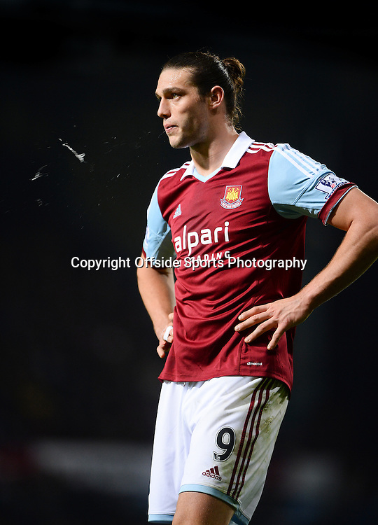 26 March 2014 - Barclays Premier League - West Ham United v Hull City - Andy Carroll of West Ham United spits - Photo: Marc Atkins / Offside.