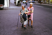 Two little old lady friends walking across the street, Montreal, 1975