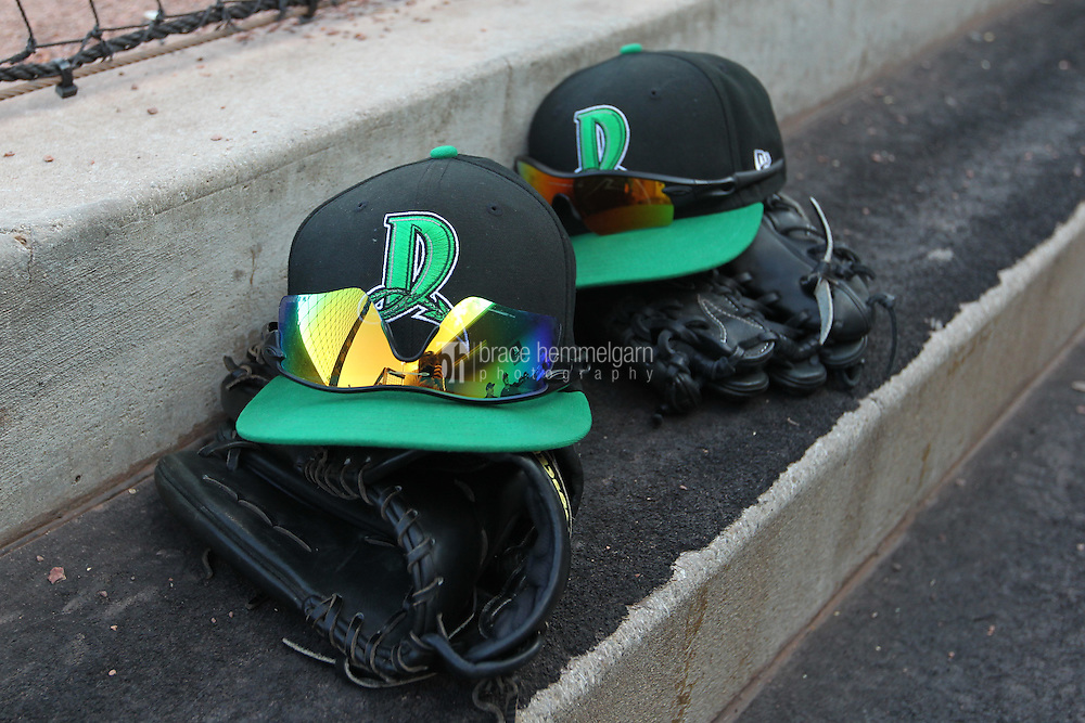 Dayton Dragons hats and gloves sit in the dugout during a game against the Lake County Captains at Fifth Third Field on June 25, 2012 in Dayton, Ohio. Lake County defeated Dayton 8-3. (Brace Hemmelgarn)