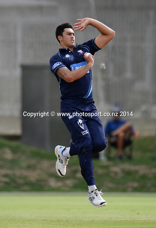 Tipene Friday bowling during the Ford Trophy 50 over One Day match between the Auckland Aces and Otago Volts at Eden Park Outer Oval, Auckland on Sunday 23 March 2014. Photo: Andrew Cornaga / www.Photosport.co.nz