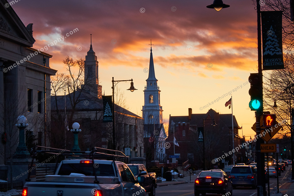 Sunrise during morning rush hour through Dedham Center. Dramatic Sunrise in Traffic.