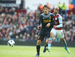 BIRMINGHAM, ENGLAND - Easter Sunday, March 31, 2013: Liverpool's Luis Alberto Suarez Diaz in action against Aston Villa's Fabian Delph during the Premiership match at Villa Park. (Pic by David Rawcliffe/Propaganda)