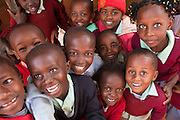 The children at St Patrick's primary school in Thika, Kenya. 75% of the pupils are from the Kiandutu slum and the school run a feeding program helping over 250 children.  The kitchen was built by AFCIC (Action for children in conflict) and the cooks wages are paid by AFCIC.