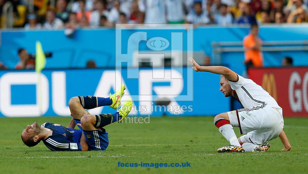 Germany's Benedikt Howedes tackles Argentina's Pablo Zabaleta during the 2014 FIFA World Cup Final match at Maracana Stadium, Rio de Janeiro<br /> Picture by Andrew Tobin/Focus Images Ltd +44 7710 761829<br /> 13/07/2014
