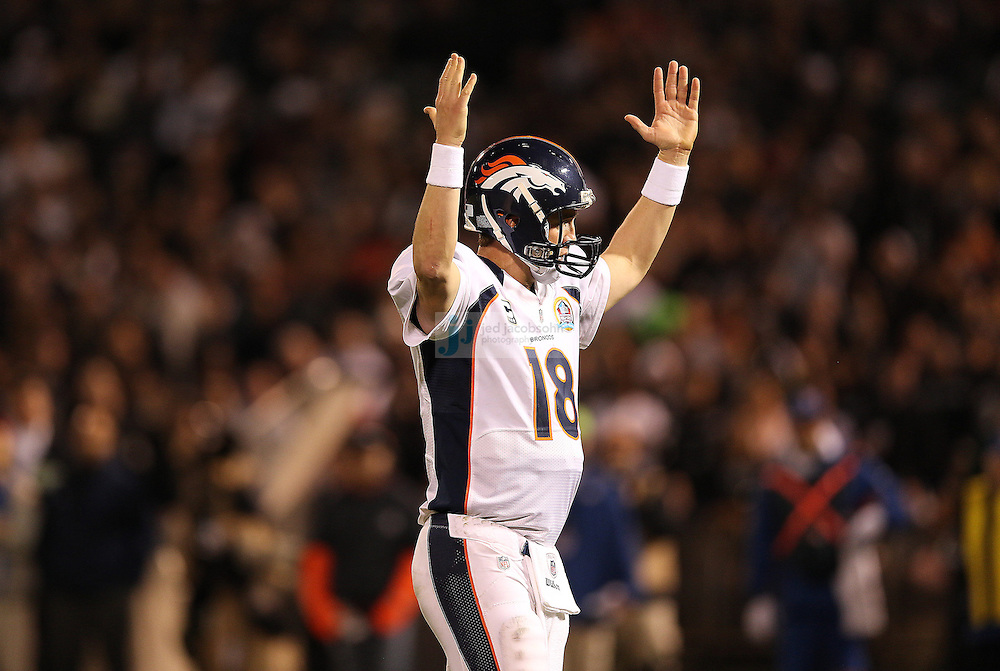 Denver Broncos quarterback Peyton Manning (18) celebrates a touchdown against  the Oakland Raiders during an NFL game on Sunday, December 6, 2012 at the Oakland Coliseum in Oakland, Ca.  (photo by Jed Jacobsohn)
