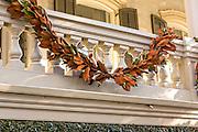 Magnolia roping decorates a historic home in Savannah, GA.