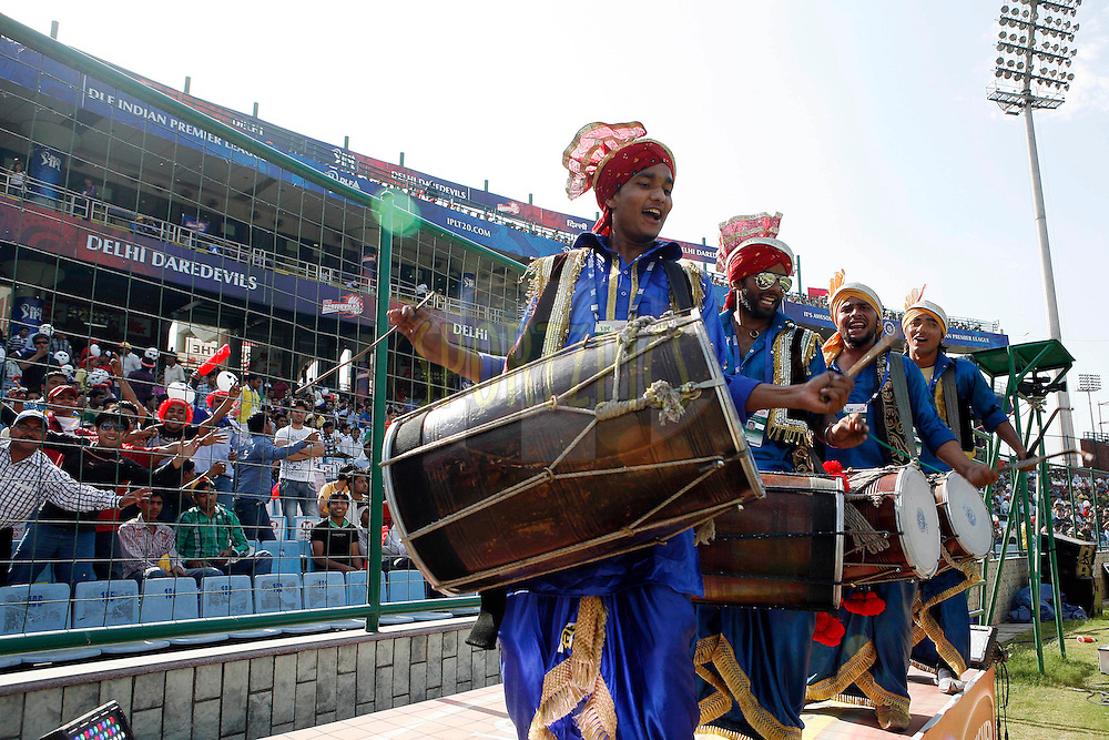 Indian men play dhol (Drums) during match 19 of the Indian Premier League ( IPL ) Season 4 between the Delhi Daredevils and the Deccan Chargers held at the Feroz Shah Kotla Stadium in Delhi, India on the 19th April 2011..Photo by Money Sharma/BCCI/SPORTZPICS.