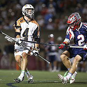 John Locascio #4 of the Rochester Rattlers looks for the ball as he is hit by Scott Ratliff #2 of the Boston Cannons during the game at Harvard Stadium on August 9, 2014 in Boston, Massachusetts. (Photo by Elan Kawesch)