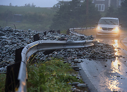 A guard rail was damaged by powerful waves that drove rocks on shore in Cow Bay, N.S. on Saturday, September 7, 2019, Canada. Hurricane Dorian brought wind, rain and heavy seas that knocked out power across the region and left damage to buildings and trees. Photo by Andrew Vaughan/CP/ABACAPRESS.COM