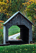 Charming covered bridge and autumn foliage, Vermont, USA.
