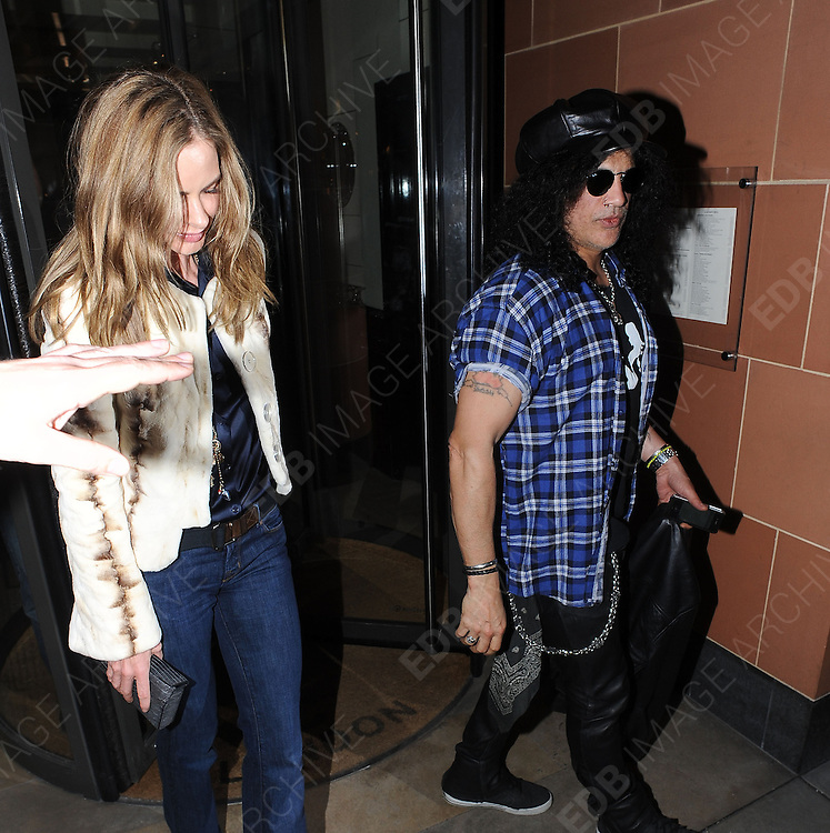 07.MARCH.2012. LONDON<br /> <br /> SLASH FROM GUNS AND ROSES ALONG WITH TRINNY WOODHALL A BIT OF OF A WEIRD COMBINATION TOGETHER LEAVING THE CIPRIANI RESTAURANT IN MAYFAIR, LONDON<br /> <br /> BYLINE: EDBIMAGEARCHIVE.COM<br /> <br /> *THIS IMAGE IS STRICTLY FOR UK NEWSPAPERS AND MAGAZINES ONLY*<br /> *FOR WORLD WIDE SALES AND WEB USE PLEASE CONTACT EDBIMAGEARCHIVE - 0208 954 5968*