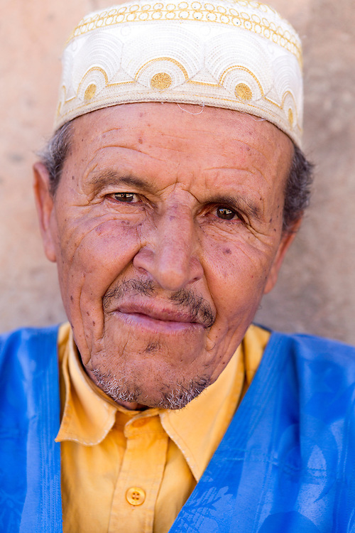 TAGADIRT, MOROCCO - MAY 26TH 2016 - A local sits outside the Tagadirt Granary (Agadir Tagadirt), Ighrem and Tafraoute province of the Souss Massa Draa, Southern Morocco.