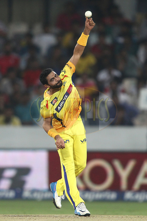 Ravindra Jadeja of the Chennai Super Kings sends down a delivery during the second semi final match of the Oppo Champions League Twenty20 between the Kings XI Punjab and the Chennai Superkings held at the Rajiv Gandhi Cricket Stadium, Hyderabad, India on the 2nd October 2014<br /> <br /> Photo by:  Shaun Roy / Sportzpics/ CLT20<br /> <br /> <br /> Image use is subject to the terms and conditions as laid out by the BCCI/ CLT20.  The terms and conditions can be downloaded here:<br /> <br /> http://sportzpics.photoshelter.com/gallery/CLT20-Image-Terms-and-Conditions-2014/G0000IfNJn535VPU/C0000QhhKadWcjYs