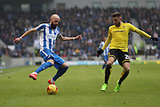 Brighton & Hove Albion full back Bruno Saltor (Captain) (2) adn Burton Albion midfielder Michael Kightly (28) during the EFL Sky Bet Championship match between Brighton and Hove Albion and Burton Albion at the American Express Community Stadium, Brighton and Hove, England on 11 February 2017.