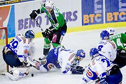 Jure Kralj (HDD Tilia Olimpija, #18) vs Bernhard Starkbaum (EC REKORD-Fenster VSV, #29) during ice-hockey match between HDD Tilia Olimpija and EC REKORD-Fenster VSV in 15th Round of EBEL league, on October 26, 2010 at Hala Tivoli, Ljubljana, Slovenia. (Photo By Matic Klansek Velej / Sportida.com)