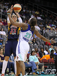 June 3, 2012; Newark, NJ, USA; Indiana Fever forward Katie Douglas (23) looks to shoot while being defended by New York Liberty guard Cappie Pondexter (23) during the second half at the Prudential Center. The Liberty defeated the Fever 87-72.