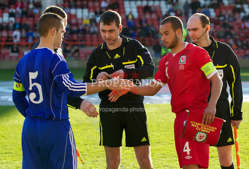 WREXHAM, WALES - Wednesday, February 29, 2012: Wales' captain Ashley Richards (Swansea City), referee Vital Sevastsyanik (Belarus) and Andorra's captain Alex Roca (FC Andorra) before the UEFA Under-21 Championship Qualifying Group 3 match at the Racecourse Ground. (Pic by Vegard Grott/Propaganda)