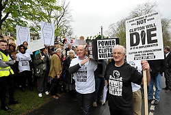 © Licensed to London News Pictures. 02/04/2014; Bristol, UK.  Tony Miles (right), aka Smiley Miley from the Radio 1 Roadshow, speaks at the start of street march by residents and traders from Clifton Village in Bristol to Bristol City Hall to protest about plans for a Residents Parking Zone in their area.  They say the business and social life of the area will be hit very hard by the RPZ with customers and visitors unable to park, and that some businesses will have to close or move away from the area.  Bristol's elected Mayor, George Ferguson, came out to meet the protesters which were led by Tony Miles aka Smiley Miley from the Radio 1 Roadshow.<br /> Photo credit: Simon Chapman/LNP