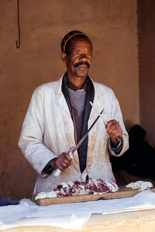 ASSAISS, MOROCCO - October 28th 2015 - Portrait of a local butcher at the Assaiss market, Sirwa Mountain Range,  Souss Massa Draa region of Southern Morocco