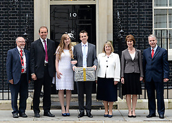 © Licensed to London News Pictures. 12/06/2012. Westminster, UK. (left to right) Jim Dobbin MP, David Burrows MP, Ryhs and Esther Curnow, newlyweds, Fiona Bruce MP, Sharon James, Colin Heart C4M campaign director. The coalition for Marriage (C4M) hand in a petition on Downing Street today 12 June 2012 calling on the government to not to redefine the rules on marriage, allowing same sex couples to marry. Photo credit : Stephen Simpson/LNP