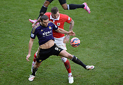 West Ham's Andy Carroll shields the ball from Bristol City's Aden Flint - Photo mandatory by-line: Alex James/JMP - Mobile: 07966 386802 - 25/01/2015 - SPORT - Football - Bristol - Ashton Gate - Bristol City v West Ham United - FA Cup Fourth Round