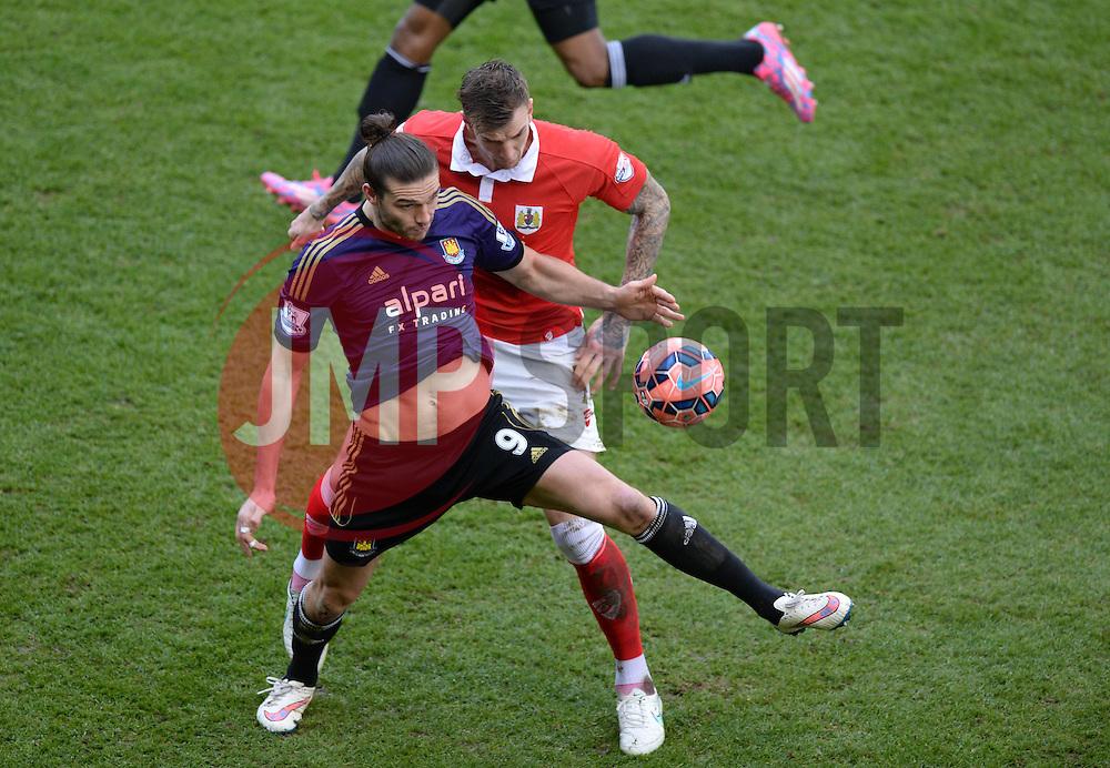 West Ham's Andy Carroll shields the ball from Bristol City's Aden Flint - Photo mandatory by-line: Alex James/JMP - Mobile: 07966 386802 - 25/01/2015 - SPORT - Football - Bristol - Ashton Gate - Bristol City v West Ham United - FA Cup Fourth Round